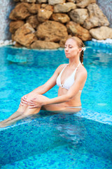 Woman relaxing in the pool at Spa center