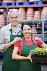 Hispanic couple working at garden center