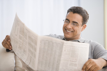 Hispanic man reading newspaper