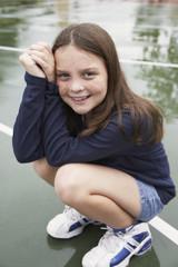 Girl crouching on playground
