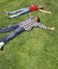 African mother and son laying in grass