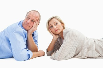 Mature couple lying and thinking
