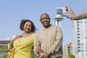 African American couple having photograph taken