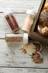 Different sea salt in bottles, close up