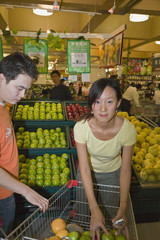 Asian couple in grocery store