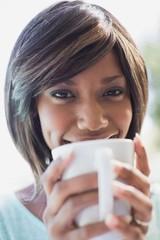 Pretty woman sitting outside having coffee