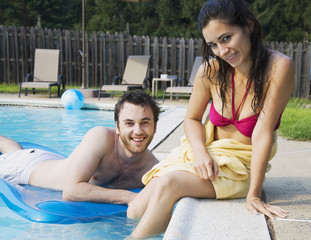 Middle Eastern couple in swimming pool