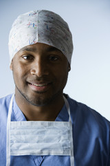 African American male doctor wearing surgical cap