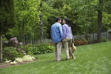 Hispanic couple holding hands