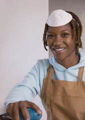 African American woman wearing woodworking mask