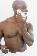African American man applying shaving cream
