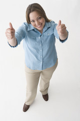 Hispanic woman giving two thumbs up