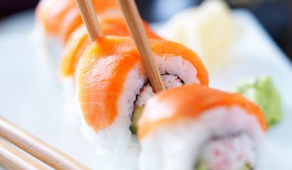 eating sushi with chopstricks panorama photo