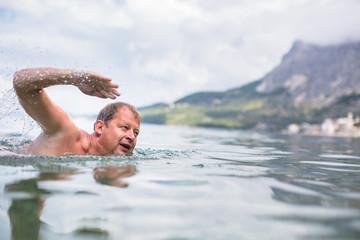 Senior man swimming in the Sea/Ocean