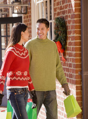 Asian couple carrying shopping bags