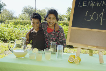 Hispanic siblings selling lemonade