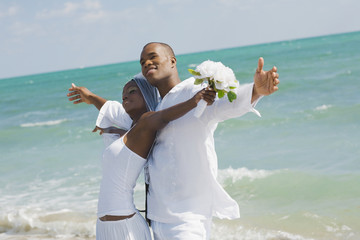 African bride and groom at beach