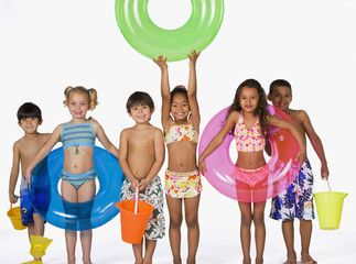 Multi-ethnic children wearing bathing suits