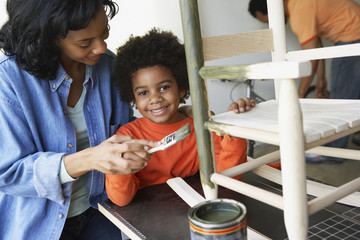 African mother and son painting rocking chair