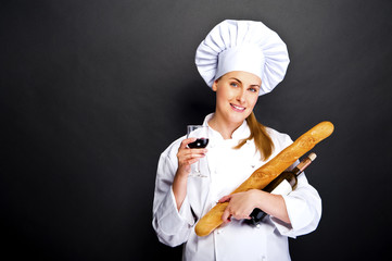 woman chef with french bread and wine glass