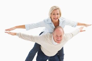 Happy mature couple having fun