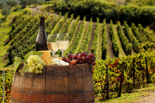 Wall mural White wine with barell in vineyard, Chianti, Tuscany, Italy