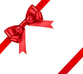 composition with red ribbons and a bow isolated on white