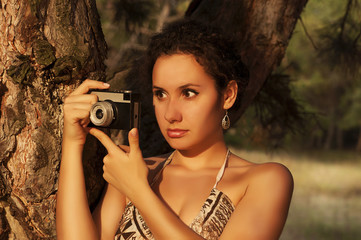 Woman with camera. Retro style.