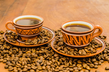 Coffee on a wooden table with grains