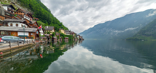 Hallstatt village in Alps at misty day, Austria