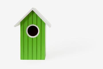 green nest box birdhouse house for birds isolated on white backg
