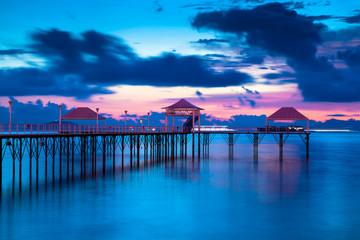 Sunset pier along coast