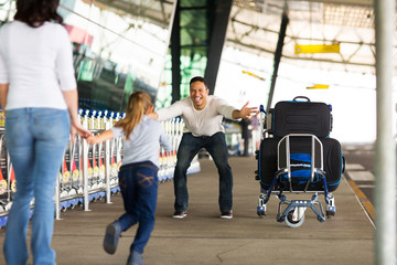little girl running to her father at airport