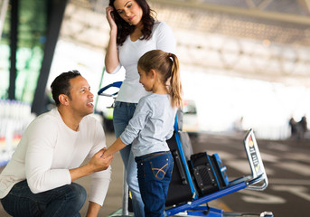 man talking to her daughter at airport before departure