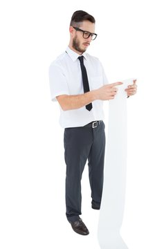 Geeky young businessman reading long receipt