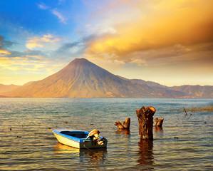 Beatiful sunset at the lake Atitlan near the volcano.