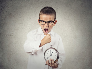 Angry screaming, child, boy holding alarm clock, time is money