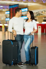 couple with luggage bags at airport