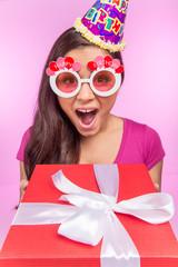 happy teenage girl with gift box.