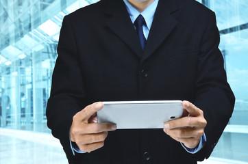 Wall Mural - Businessman using tablet
