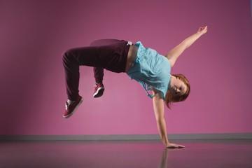 Pretty break dancer doing a handstand