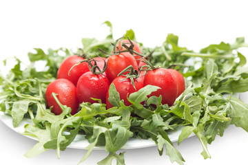 tomatoes and arugula on a plate