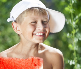 boy eating a hot summer day juicy watermelon