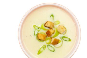 Leek and Potato soup with croutons. Selective focus.