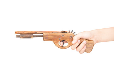 Toy gun made of wood isolated on white background