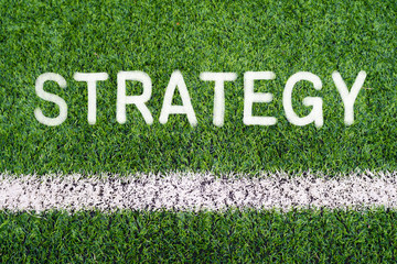 STRATEGY hand writing text on soccer field grass