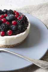 mini cheesecake with red fruits on plate with fork
