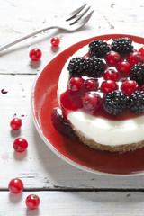 cheesecake with blackberries blueberries and red currant