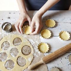 girl hands making shortcrust pastry for little tart