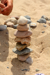 View of the pebbles stack on the sand